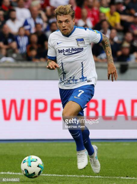 Alexander Esswein of Berlin runs with the ball during the pre season friendly match between Hertha BSC and FC Liverpool at Olympiastadion on July 29...