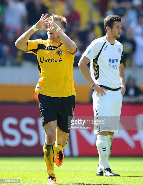 Alexander Esswein of Dresden celebrates scoring the first goal during the Third League match between Dynamo Dresden and Wacker Burghausen at the...