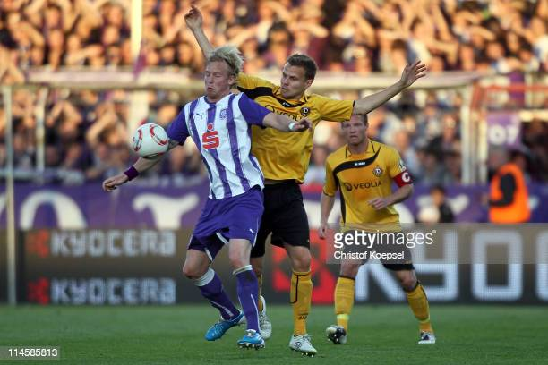 Alexander Esswein of Dresden challenges Dennis Schmidt of Osnabrueck during the Second Bundesliga playoff second leg match between Dynamo Dresden and...