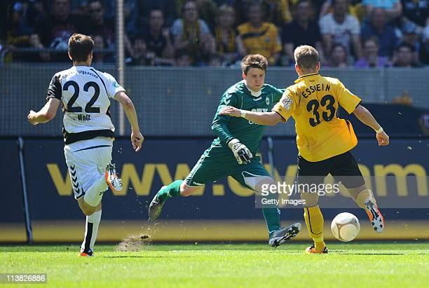 Alexander Esswein of Dresden is scoring the first goal against Keeper Rene Vollath of Burghausen during the Third League match between Dynamo Dresden...