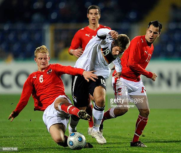 Alexander Esswein of Germany battles for the ball with Thomas Hopper and Leonhard Kaufmann of Austria during the U20 International Friendly match...
