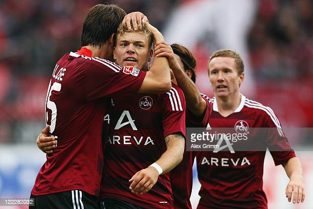 Alexander Esswein of Nuernberg celebrates his team's first goal with team mate Timm Klose during the Bundesliga match between 1 FC Nuernberg and FC...