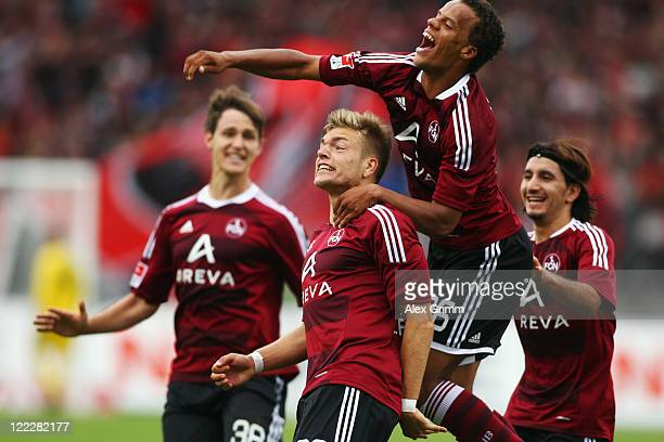 Alexander Esswein of Nuernberg celebrates his team's first goal with team mates n38 Timothy Chandler and Almog Cohen during the Bundesliga match...