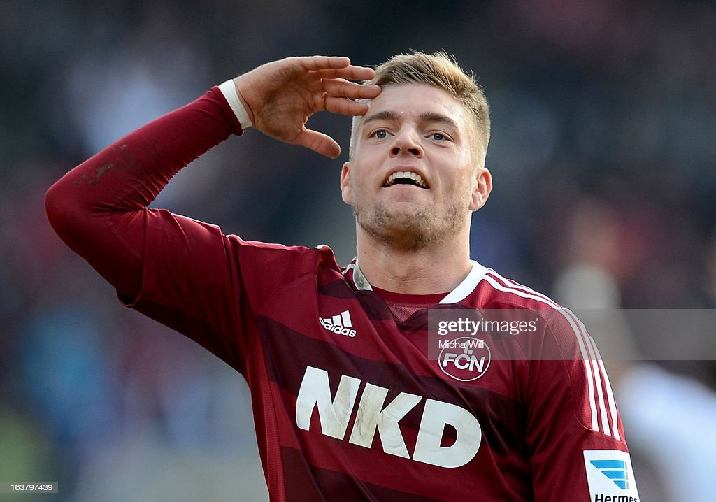 Alexander Esswein of Nuernberg celebrates/salutes after scoring his team's second goal during the Bundesliga match between 1. FC Nuernberg and FC Schalke 04 at Grundig-Stadion on March 16, 2013 in Nuremberg, Germany.