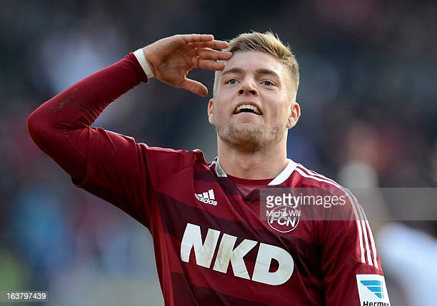 Alexander Esswein of Nuernberg celebrates/salutes after scoring his team's second goal during the Bundesliga match between 1 FC Nuernberg and FC...