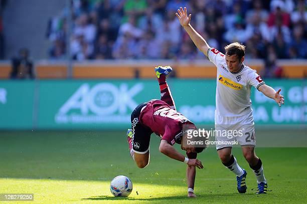 Alexander Esswein of Nuernberg is brought down by Tony Jantschke of Moenchengladbach during the Bundesliga match between Borussia Moenchengladbach...