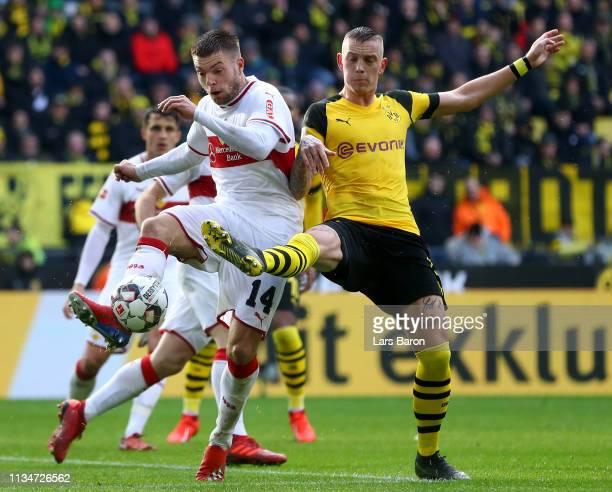 Alexander Esswein of Stuttgart challenges Marius Wolf of Dortmund during the Bundesliga match between Borussia Dortmund and VfB Stuttgart at Signal...