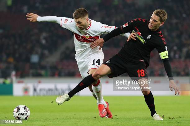 Alexander Esswein of VfB Stuttgart battles for the ball with Nils Petersen of SportClub Freiburg during the Bundesliga match between VfB Stuttgart...