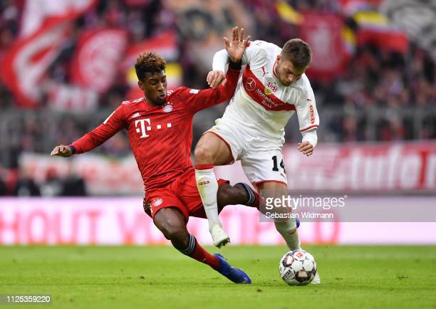 Alexander Esswein of VfB Stuttgart is challenged by Kingsley Coman of Bayern Munich during the Bundesliga match between FC Bayern Muenchen and VfB...
