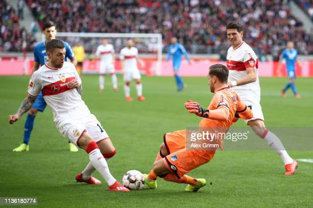 Alexander Esswein of VfB Stuttgart is challenged by Oliver Baumann of 1899 Hoffenheim during the Bundesliga match between VfB Stuttgart and TSG 1899...