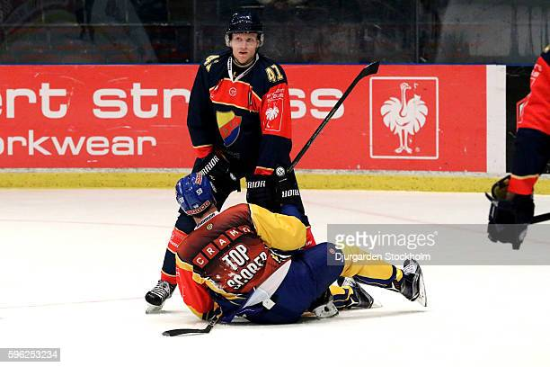 Alexander Falk of Djurgarden Stockholm topples Dario Simion of HC Davos during the third period of the Champions Hockey League match between...