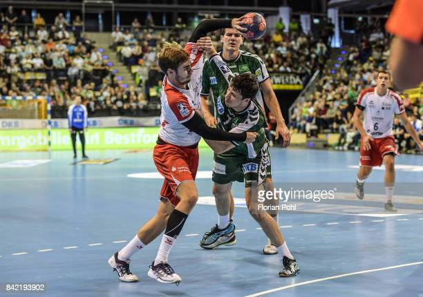 Alexander Falk of the Eulen Ludwigshafen Erik Schmidt and Kevin Struck of Fuechse Berlin during the game between Fuechse Berlin and the Eulen...