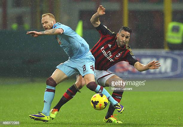 Alexander Farnerud of Torino FC competes for the ball with Adil Rami of AC Milan during the Serie A match between AC Milan and Torino FC at San Siro...