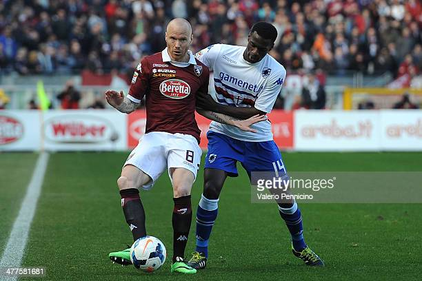 Alexander Farnerud of Torino FC is challenged by Pedro Obiang of UC Sampdoria during the Serie A match between Torino FC and UC Sampdoria at Stadio...