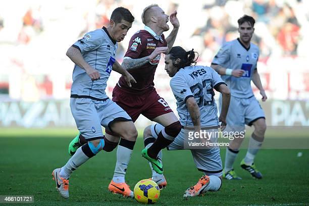 Alexander Farnerud of Torino FC is tackled by Mario Yepes of Atalanta BC during the Serie A match between Torino FC and Atalanta BC at Stadio...