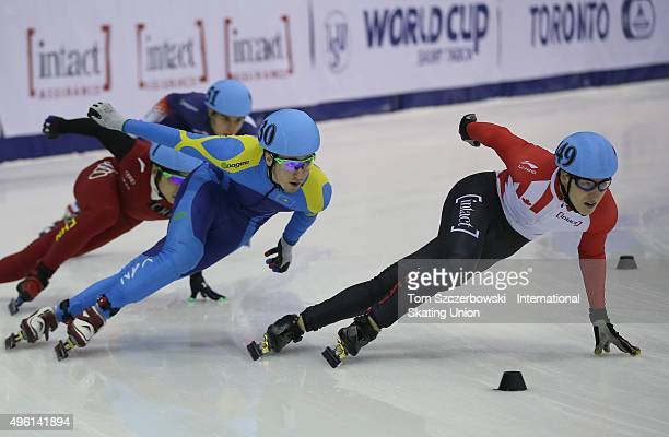 Alexander Fathoullin of Canada competes against Denis Nikisha of Kazakhstan on Day 1 of the ISU World Cup Short Track Speed Skating competition at...
