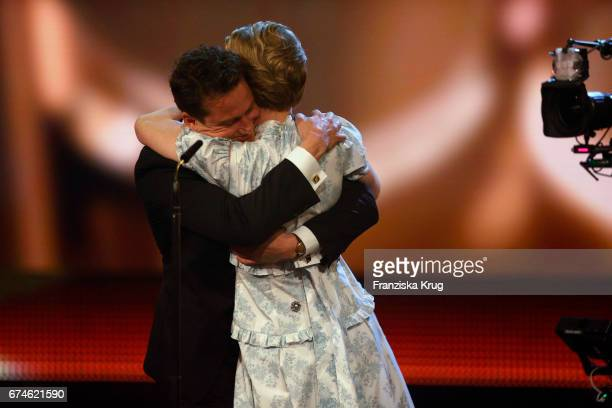 Alexander Fehling congratulates Sandra Hueller after she wins the Award for Best Actress at the Lola German Film Award show at Messe Berlin on April...
