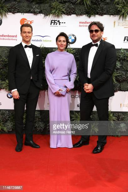 Alexander Fehling, Ronald Zehrfeld and Antje Traue attend the Lola - German Film Award red carpet at Palais am Funkturm on May 03, 2019 in Berlin,...