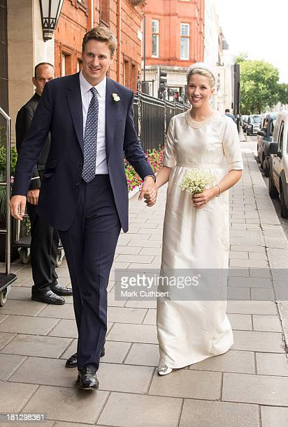 Alexander Fellowes and Alexandra Finlay arrive at their wedding reception at Claridges Hotel on September 20 2013 in London England