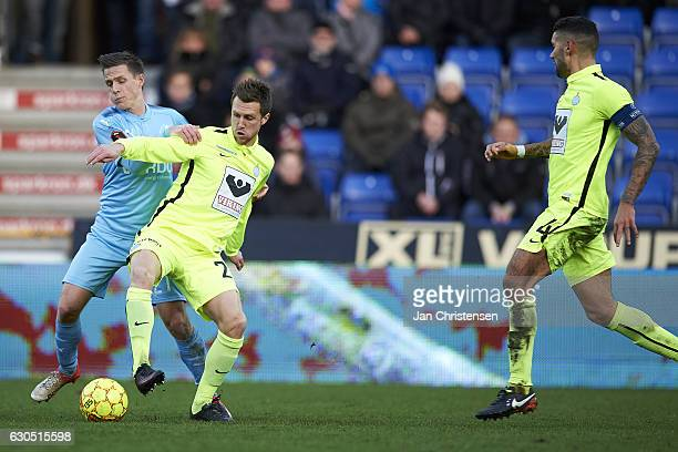 Alexander Fischer of Randers FC and Michael Jakobsen of Esbjerg fB compete for the ball during the Danish Alka Superliga match between Randers FC and...