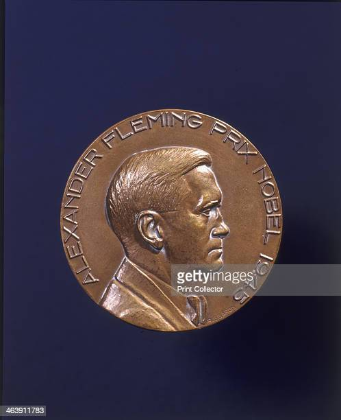 'Alexander Fleming Prix Nobel 1945' Nobel prize medal awarded to bacteriologist Alexander Fleming Fleming is shown in profile in relief with French...