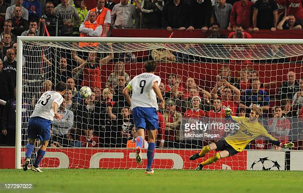 Alexander Frei of Basel beats David de Gea of Manchester United to score their third goal from the penalty spotduring the UEFA Champions League Group...