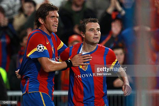 Alexander Frei of Basel celebrates his team's first goal with team mate Benjamin Huggel during the UEFA Champions League group E match between FC...
