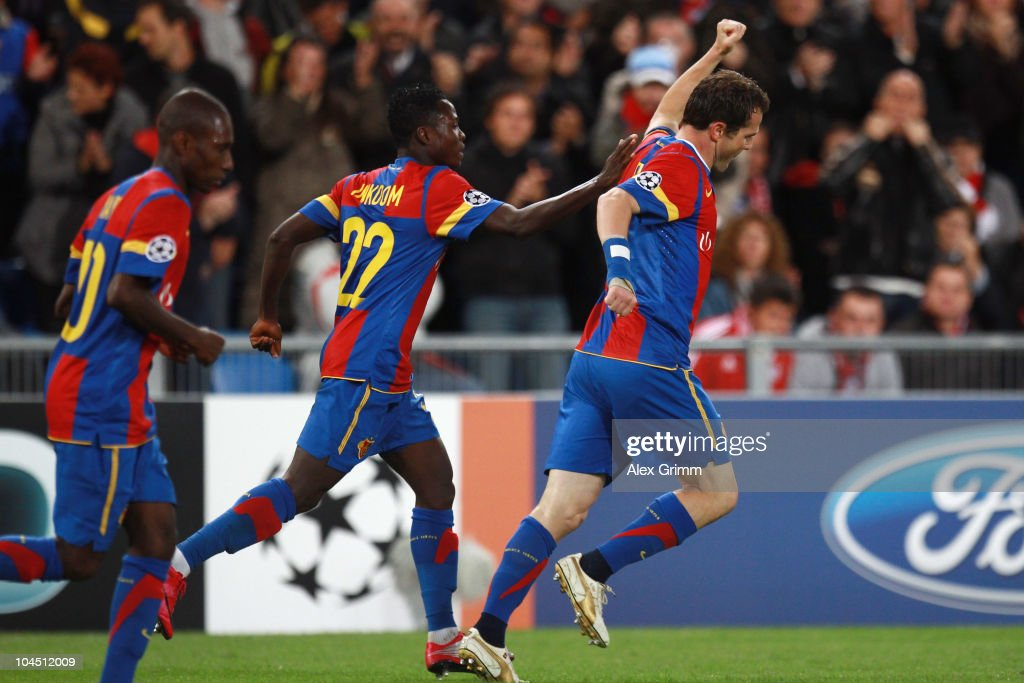 Alexander Frei of Basel celebrates his team's first goal with team mates Samuel Inkoom and Gilles Yapi-Yapo (R-L) during the UEFA Champions League group E match between FC Basel and FC Bayern Muenchen at the St. Jakob Park stadium on September 28, 2010 in Basel, Switzerland.