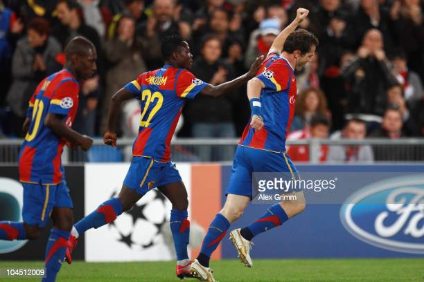 Alexander Frei of Basel celebrates his team's first goal with team mates Samuel Inkoom and Gilles Yapi-Yapo during the UEFA Champions League group E...