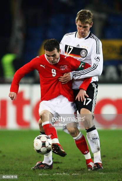 Alexander Frei of Switzerland in action with Per Mertesacker of Germany during the international friendly match between Switzerland and Germany at...