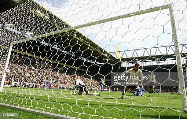 Alexander Frei shoots the first goal for Dortmund during the Bundesliga match between Borussia Dortmund and FC Schalke 04 at the Signal Iduna Park on...