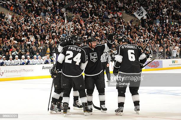 Alexander Frolov Brad Richardson and Sean O'Donnell of the Los Angeles Kings celebrate after a goal against the Vancouver Canucks in Game Six of the...