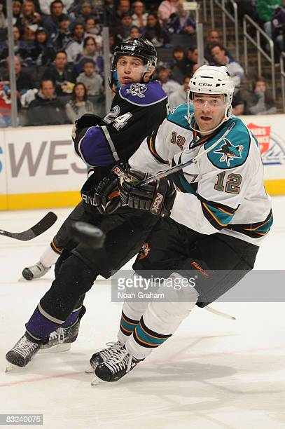 Alexander Frolov of the Los Angeles Kings and Patrick Marleau of the San Jose Sharks eye the puck during their game on October 12 2008 at Staples...