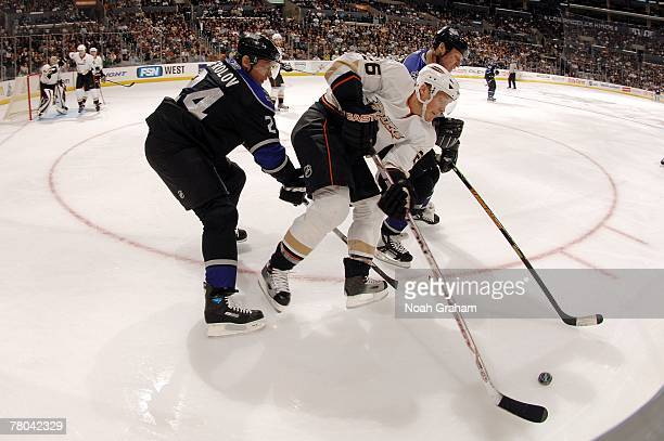 Alexander Frolov of the Los Angeles Kings battles for the puck against Samuel Pahlsson of the Anaheim Ducks on November 15 2007 at the Staples Center...