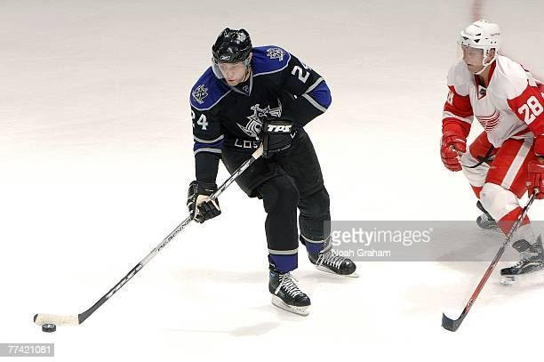 Alexander Frolov of the Los Angeles Kings handles the puck as Brian Rafalski of the Detroit Red Wings closes in during their game on October 14 2007...