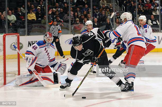 Alexander Frolov of the Los Angeles Kings handles the puck while goaltender Stephen Valiquette of the New York Rangers defends during their game...