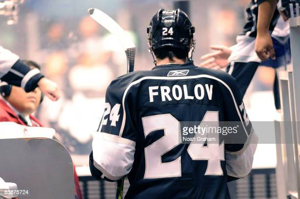 Alexander Frolov of the Los Angeles Kings high fives fans as he takes the ice during warmups prior to the game against the Toronto Maple Leafs on...