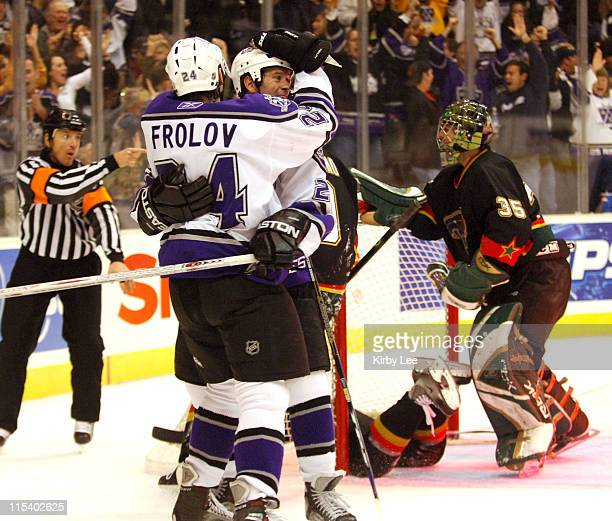 Alexander Frolov of the Los Angeles Kings is embraced teammate Craig Conroy after scoring a goal with 27 seconds left in regulation as Dallas Stars...