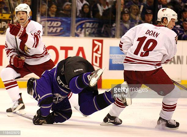 Alexander Frolov of the Los Angeles Kings is upended by Shane Doan of the Phoenix Coyotes during 41 victory at the Staples Center in Los Angeles...
