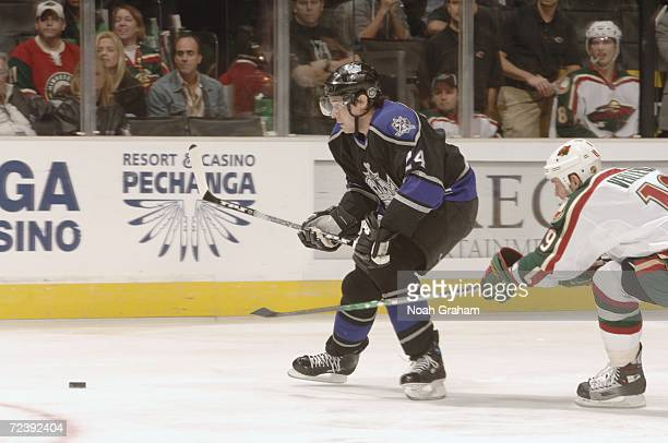 Alexander Frolov of the Los Angeles Kings plays the puck against the Minnesota Wild during the NHL game on October 18 2006 at the Staples Center in...