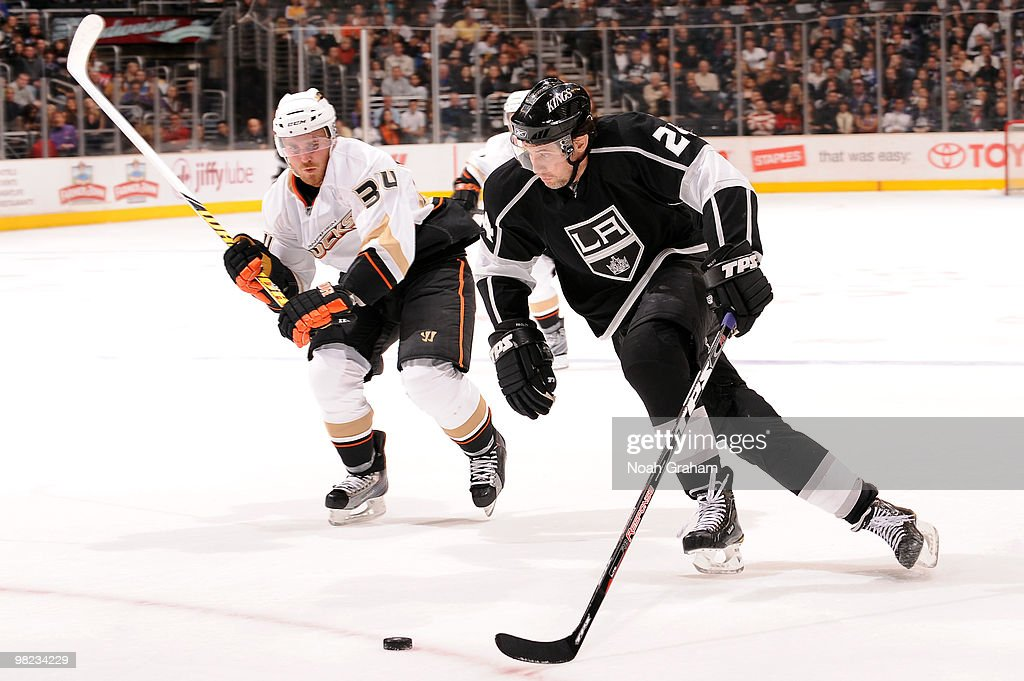 Alexander Frolov #24 of the Los Angeles Kings skates with the puck against James Wisniewski #34 of the Anaheim Ducks on April 3, 2010 at Staples Center in Los Angeles, California.