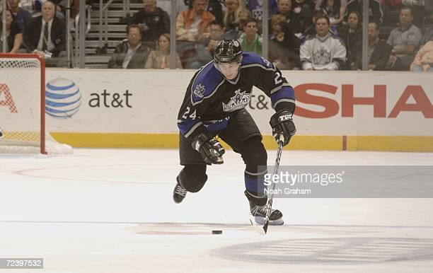 Alexander Frolov of the Los Angeles Kings skates with the puck against the Minnesota Wild during the NHL game on October 18 2006 at the Staples...