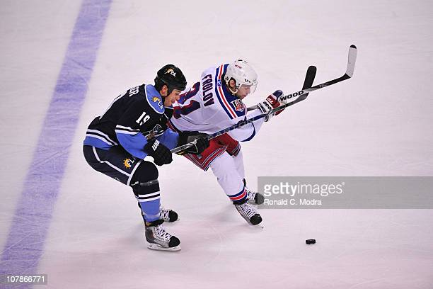 Alexander Frolov the New York Rangers crosses sticks with Marty Reasoner of the Florida Panthers during a NHL game on January 2 2011 at the...