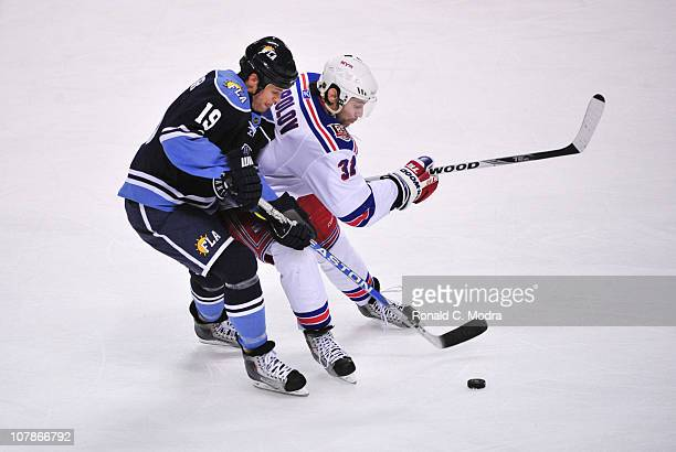 Alexander Frolov the New York Rangers tangles with Marty Reasoner of the Florida Panthers during a NHL game on January 2 2011 at the BankAtlantic...