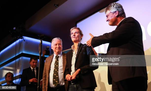 Alexander Gauland , Alice Weidel, co-leads candidate of the Alternative for Germany and Joerg Meuthen celebrate the initial results that give the...