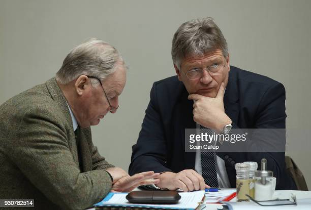 Alexander Gauland and Joerg Meuthen of the rightwing Alternative for Germany political party chat before speaking to the media prior to this...