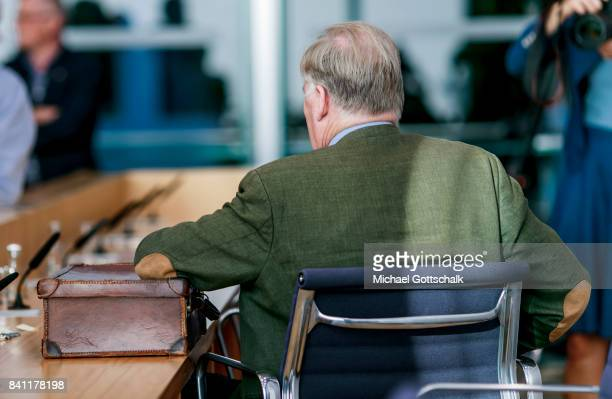 Alexander Gauland member of right wing party AFD Alternative fuer Deutschland or Alternative For Germany sits next to his suitcase during a press...