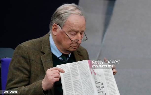 Alexander Gauland parliamentary group coleader of Germany's farright Alternative for Germany party reads a newspaper as he attends a session of the...