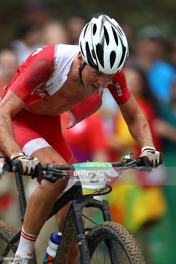 Alexander Gehbauer of Austria rides rides during the Men's Cross-Country on Day 16 of the Rio 2016 Olympic Games at Mountain Bike Centre on August 21, 2016 in Rio de Janeiro, Brazil.