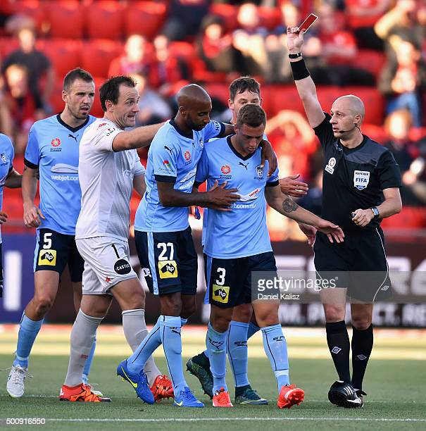 Alexander Gersbach of Sydney is shown the red card by the referee during the round 10 ALeague match between Adelaide United and Sydney FC at Coopers...